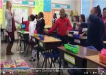 Teacher starts class with positive song and dance routine